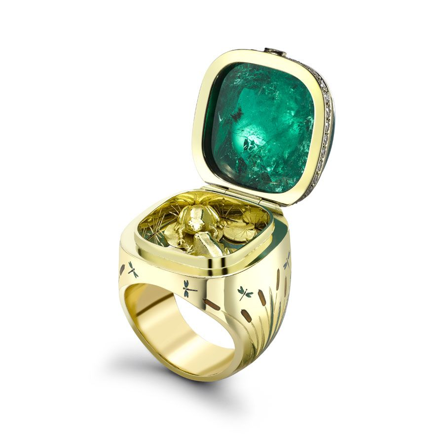 Gemfields and Theo Fennell collaborate to create emerald Kissing Frogs ring - ring opens to reveal to adorable kissing frogs. Emerald and diamonds.