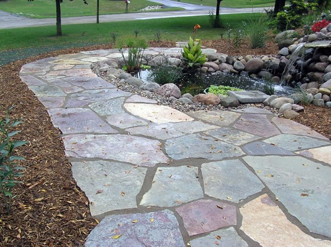 types of flagstone flagstone walkway accenting a small pond - Flagstone Walkway Design Ideas