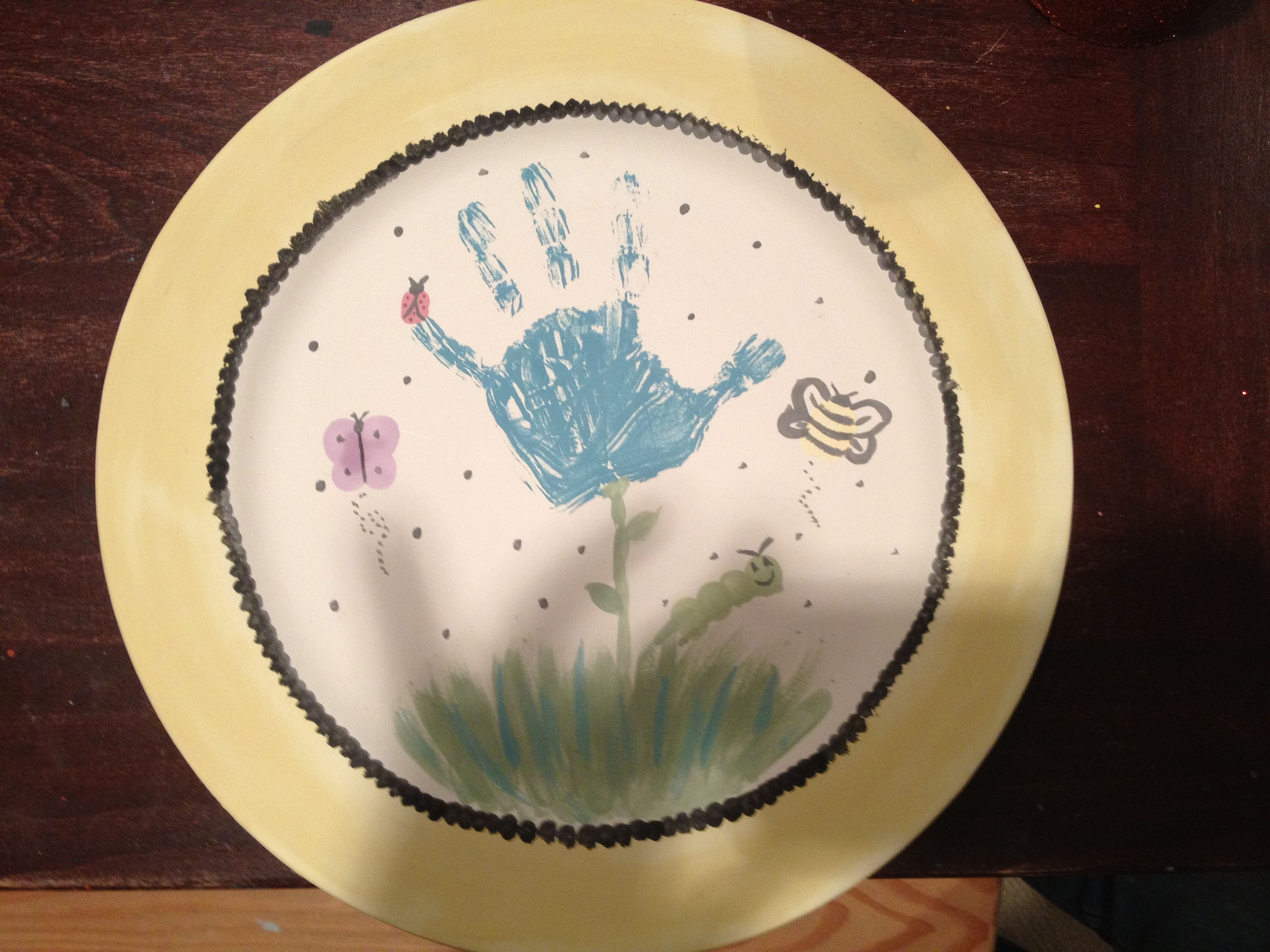Paint your own plate using hand-print and finger prints for insects. Turned out Amazing