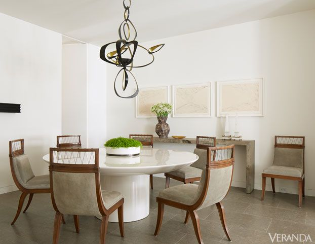 Love the way the mix-and-matching of styles create an elegant and interesting neutral dining room.