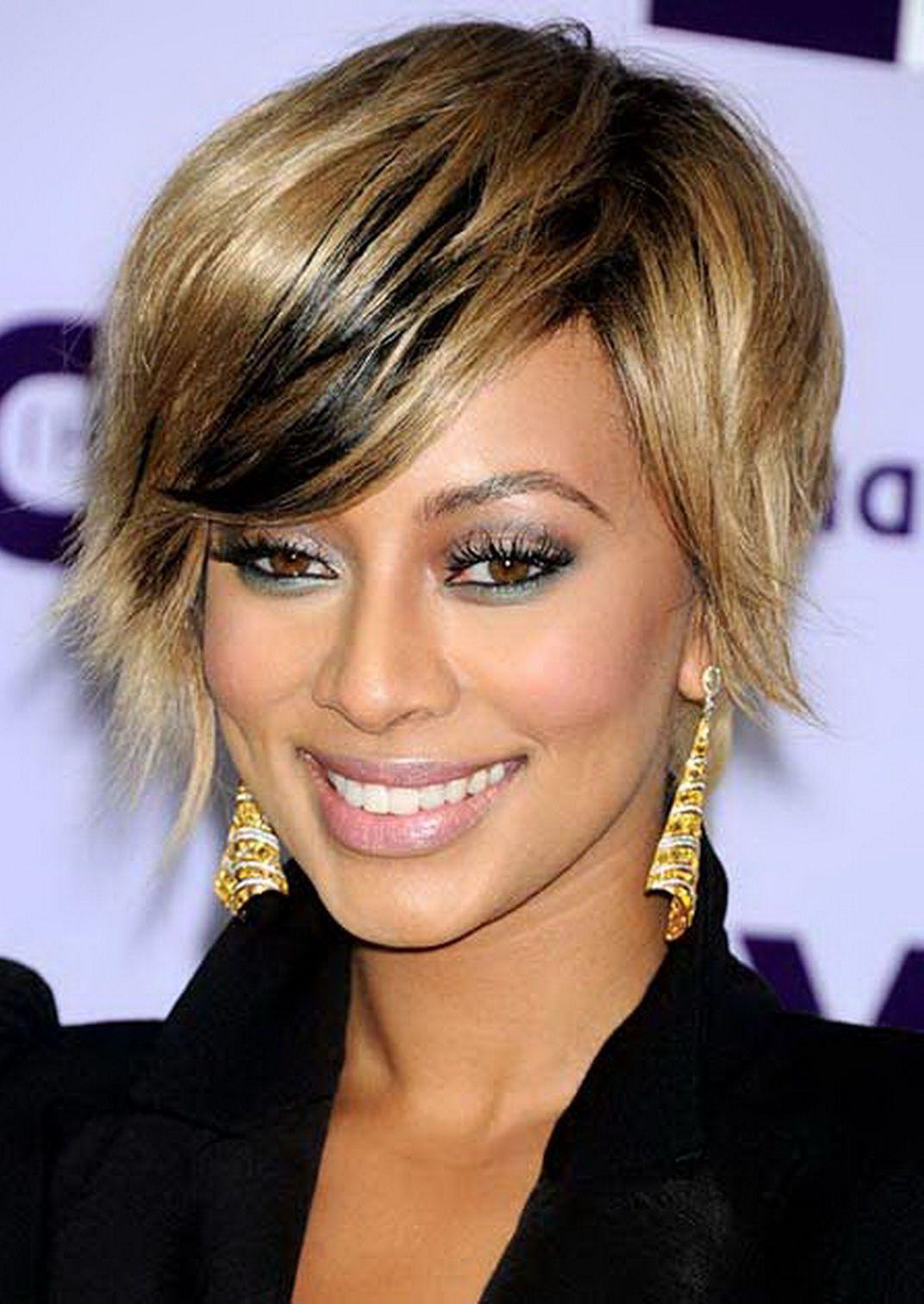 keri hilson short honey blonde and black hairstyle | short