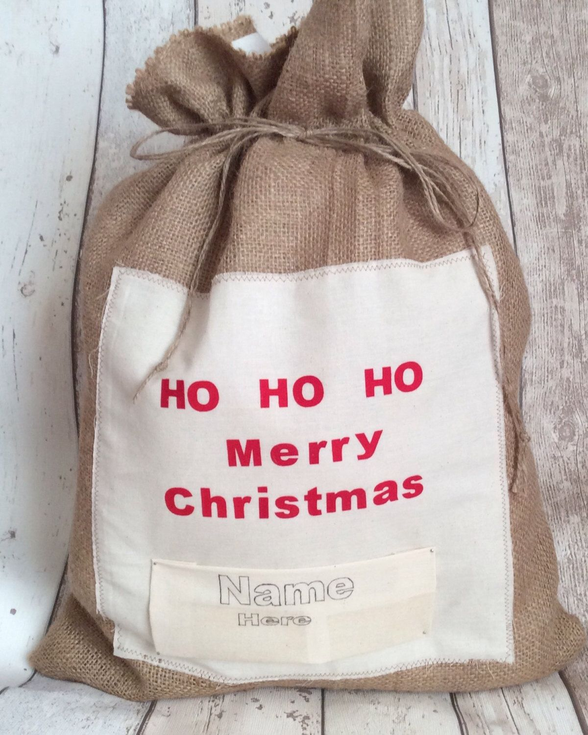 A personal favourite from my Etsy shop https://www.etsy.com/uk/listing/250399800/personalised-christmas-hessian-sack