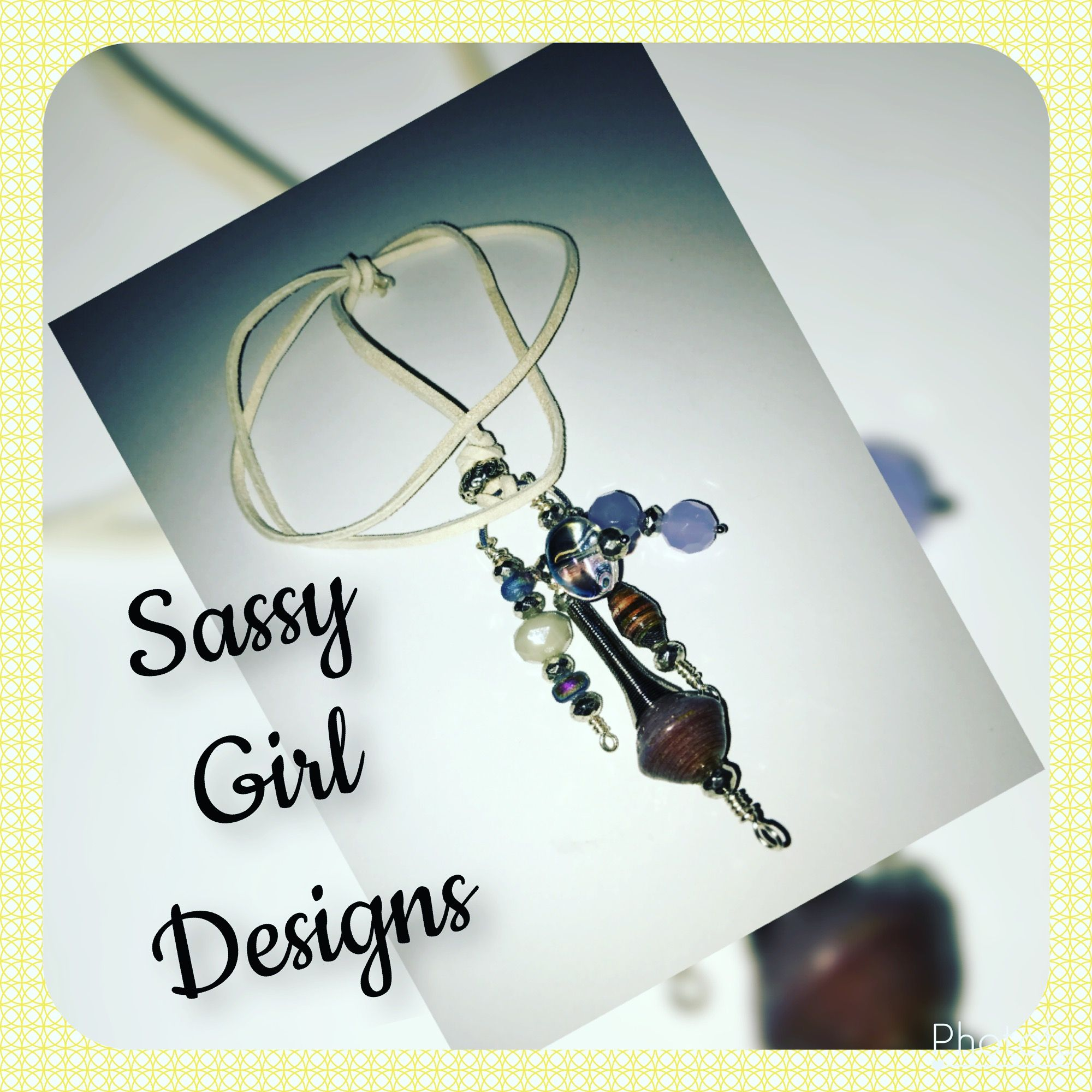 Handcrafted paper beads and gemstones on suede cording sassy