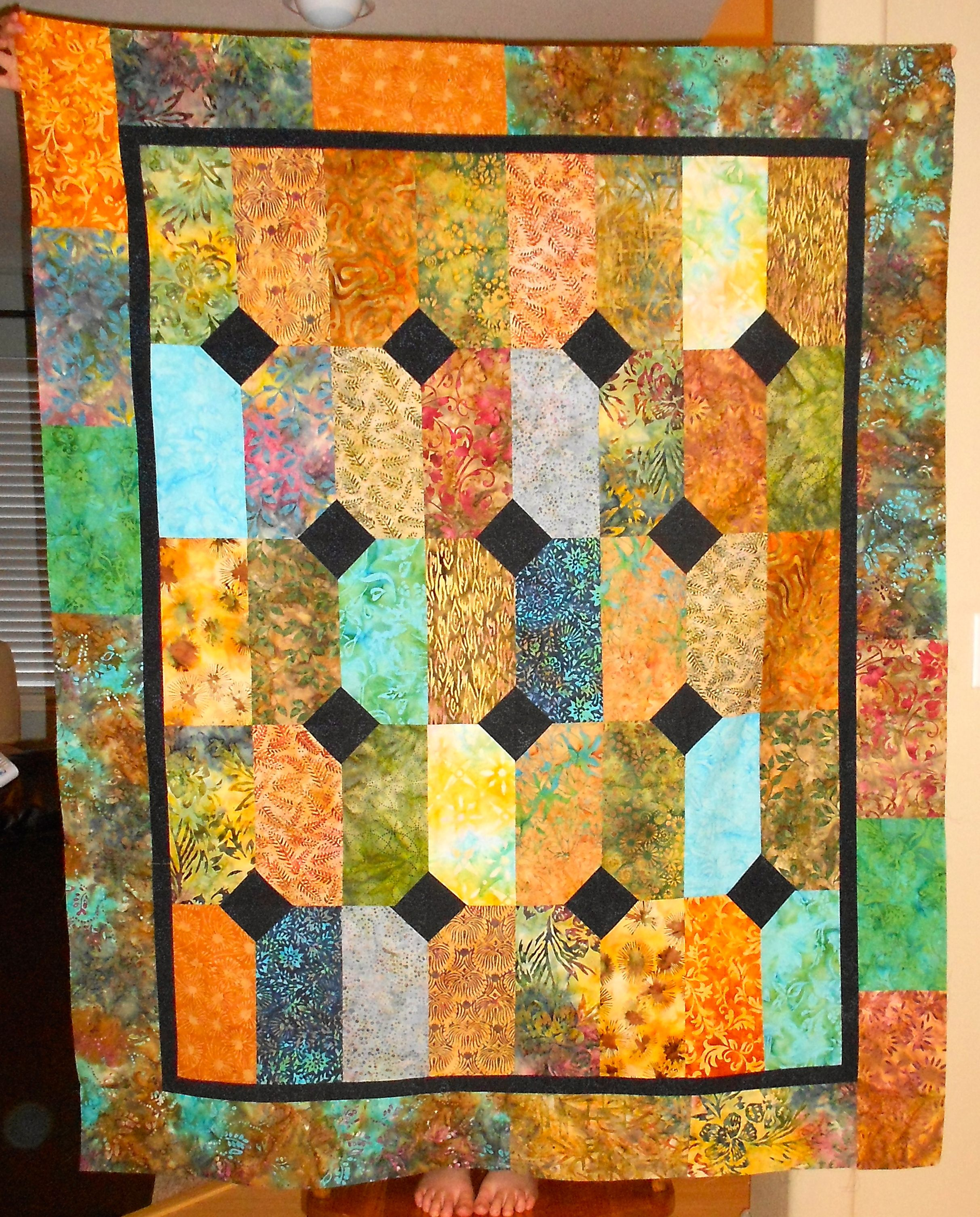 Batik Quilt Made With Layer Cakes And Navy Blue Fabric