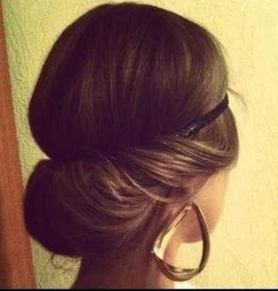 1920's hair. Hair rolled up and ends tucked under elastic headband.
