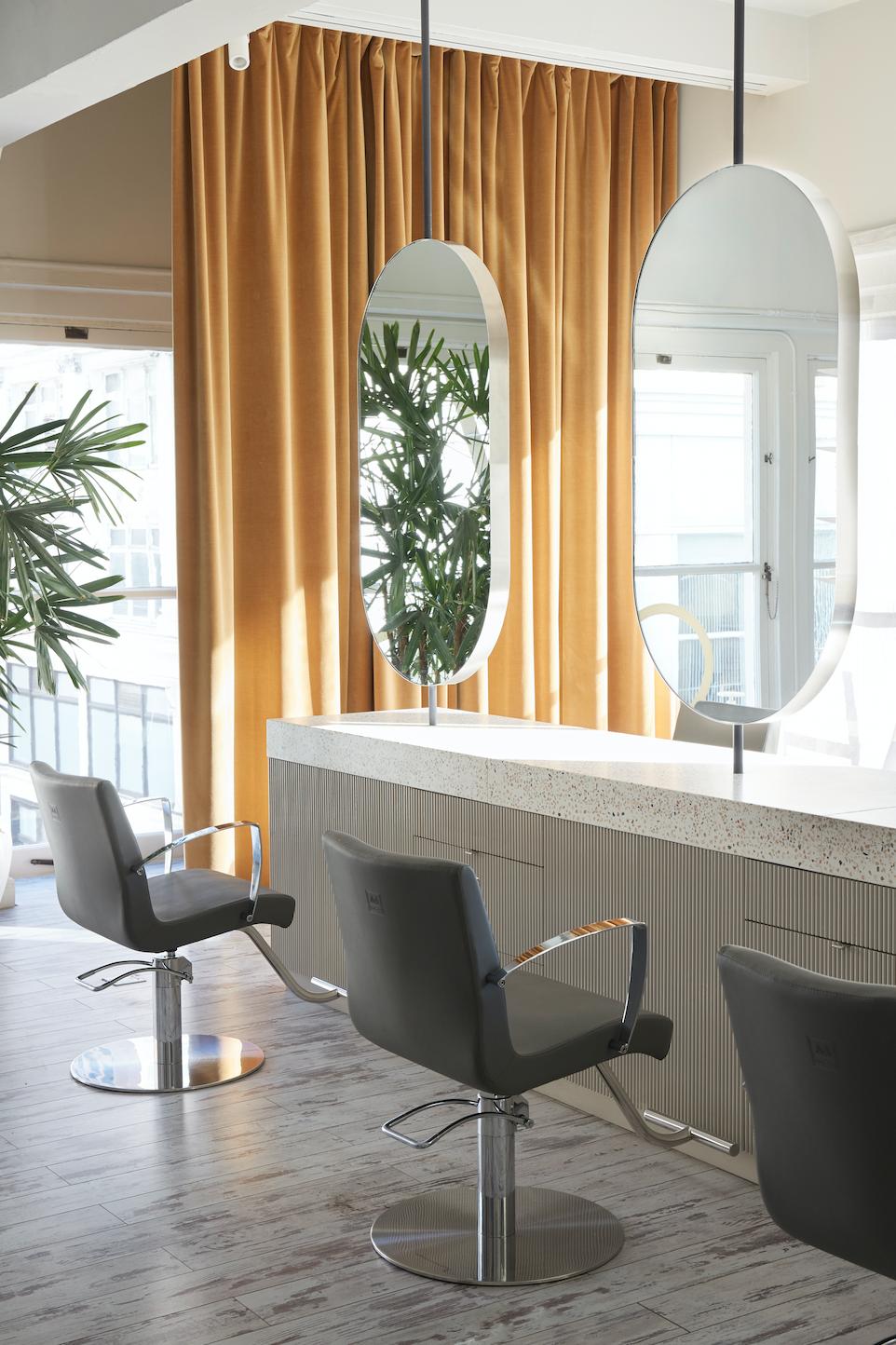 Modern hair salon design with pillshaped mirrors