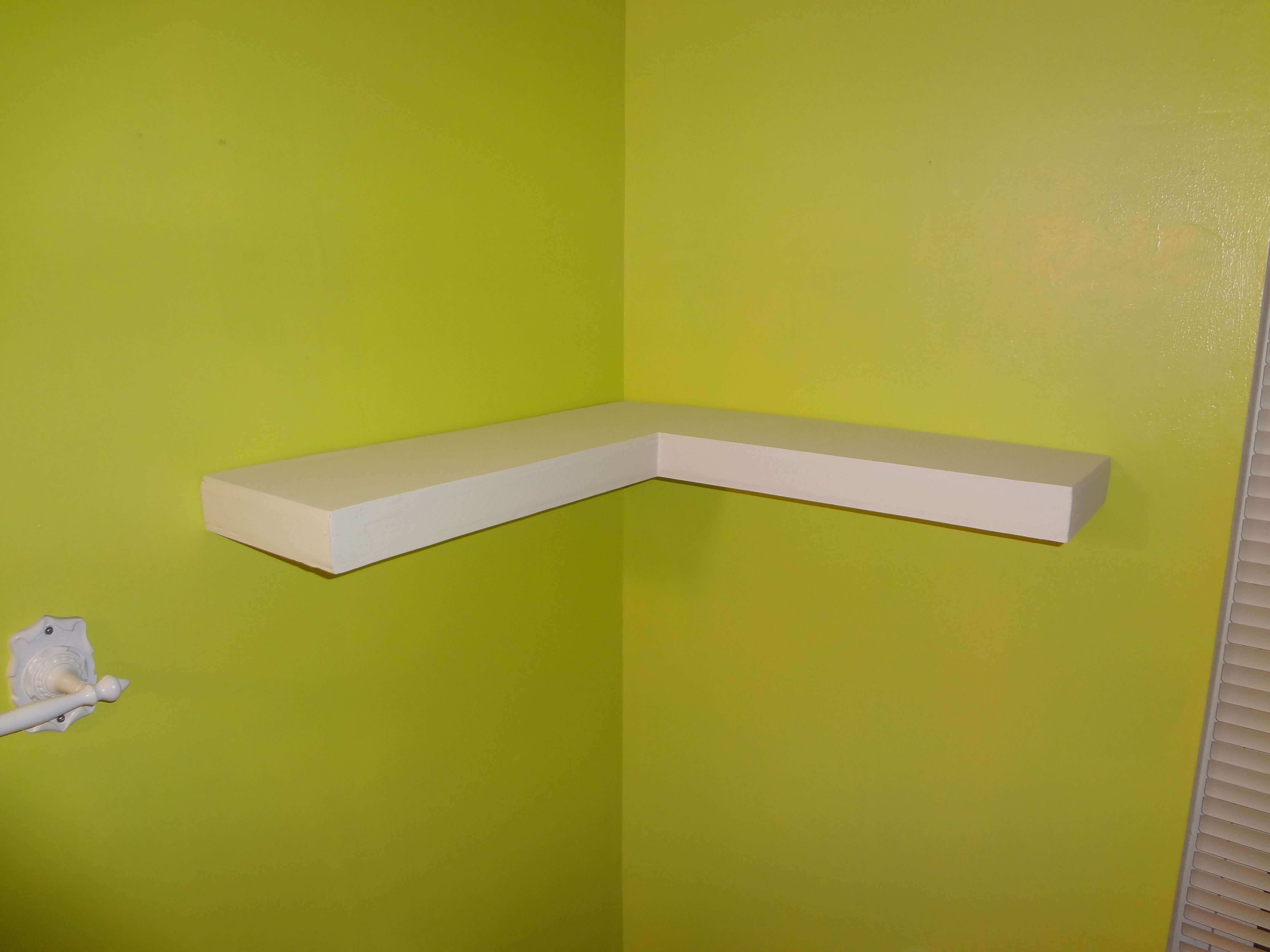 Floating Corner Shelf In White Wood Materials Near The Window And Green Colored Wall Home Office Interior Pixels