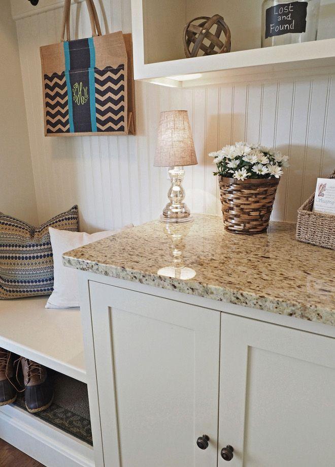Mudroom cabinet with granite countertop and creamy white cabinets