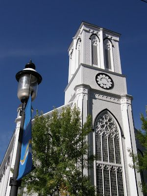 Wilmot United, the historic church in downtown Fredericton, impressive against a deep blue sky.