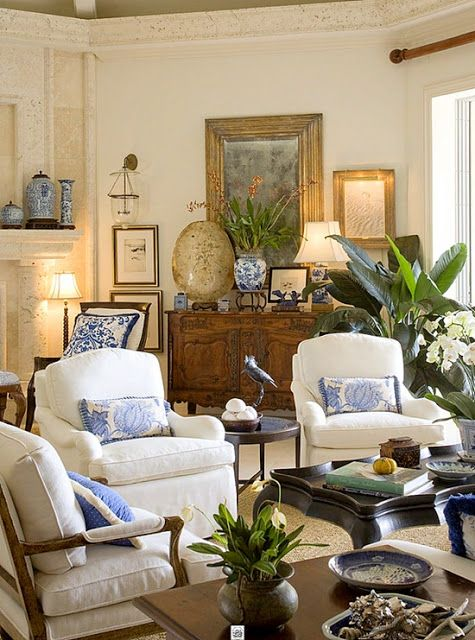Living room with white furniture and blue/white accents For the