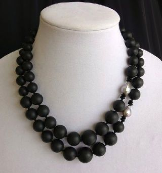 Double strand of graduated matte onyx beads accented with grey, baroque pearls. From Gemmarium Italia, maker of distinctive and imaginative hand made jewelry. SOLD