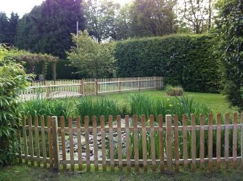 Picket Fence Erected Around Pond To Keep Children Out And