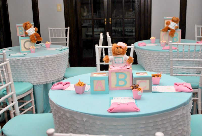 Table Centerpiece Ideas For Baby Shower find this pin and more on baby shower Baby Shower Centerpieces For Tables Were Dressed In Fitted White Ruffled Table Toppers The