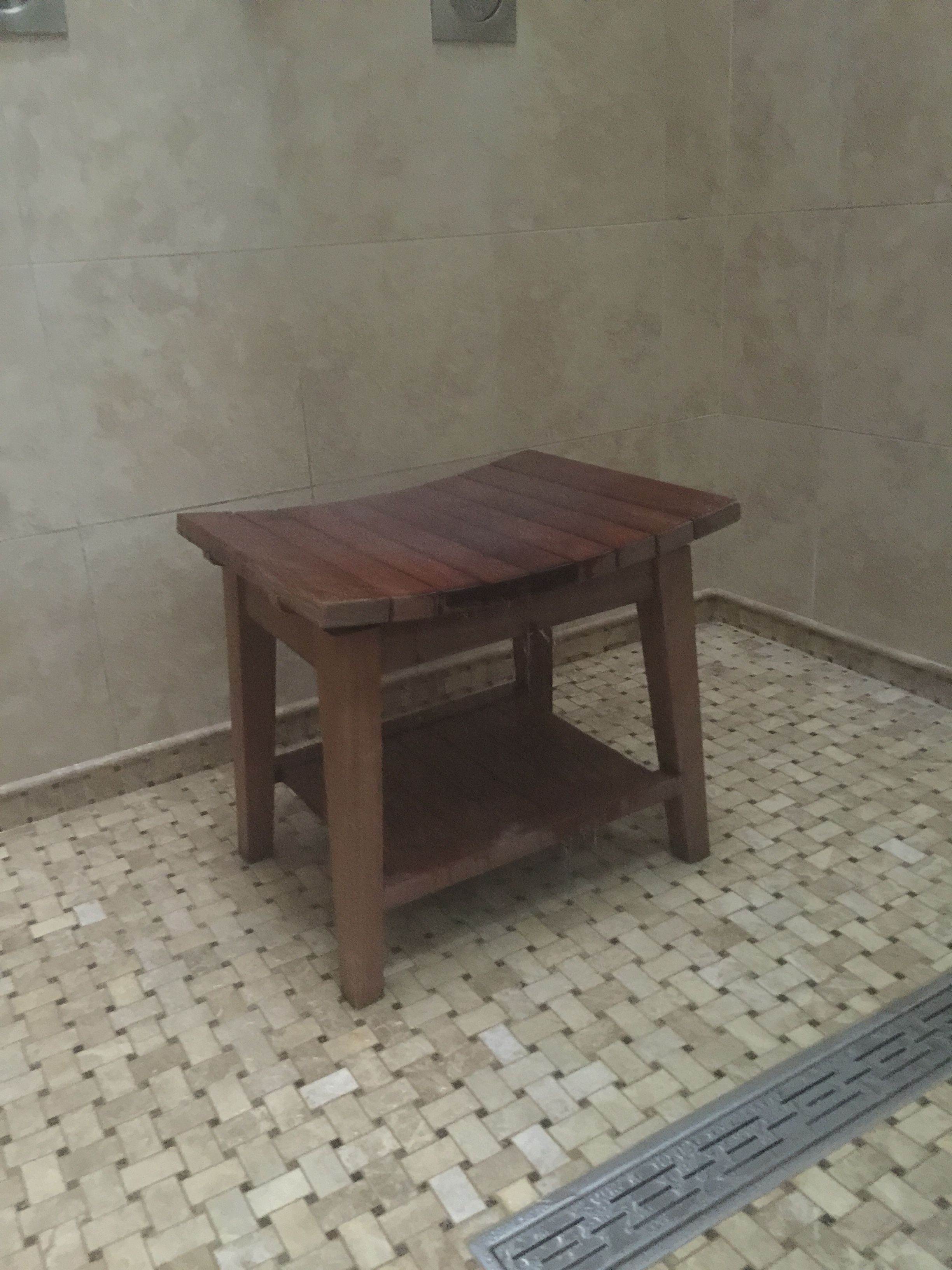 An Ipe Shower Bench Outdoor Decor