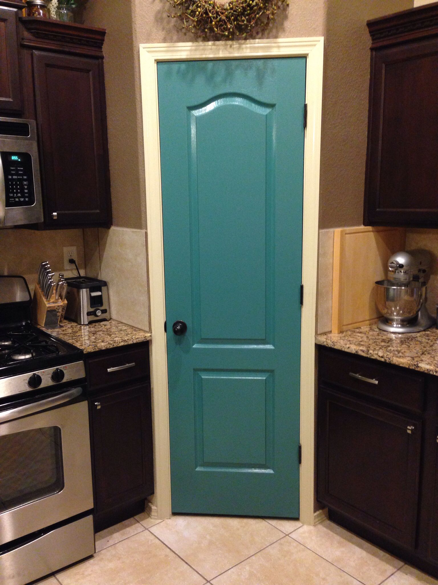 Teal Pantry Door. Such a great pop of color in the kitchen! Love it ...