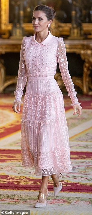 Queen Letizia charms crowds in an elegant pink lace collar dress