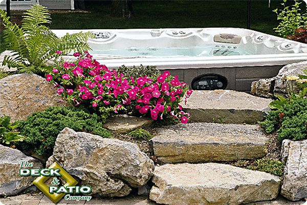 Natural Rocks Around Portable Jacuzzi Some Ideas For Using Natural Or Faux Rocks Around A Spa Or Hot Hot Tub Landscaping Hot Tub Backyard Hot Tub Designs