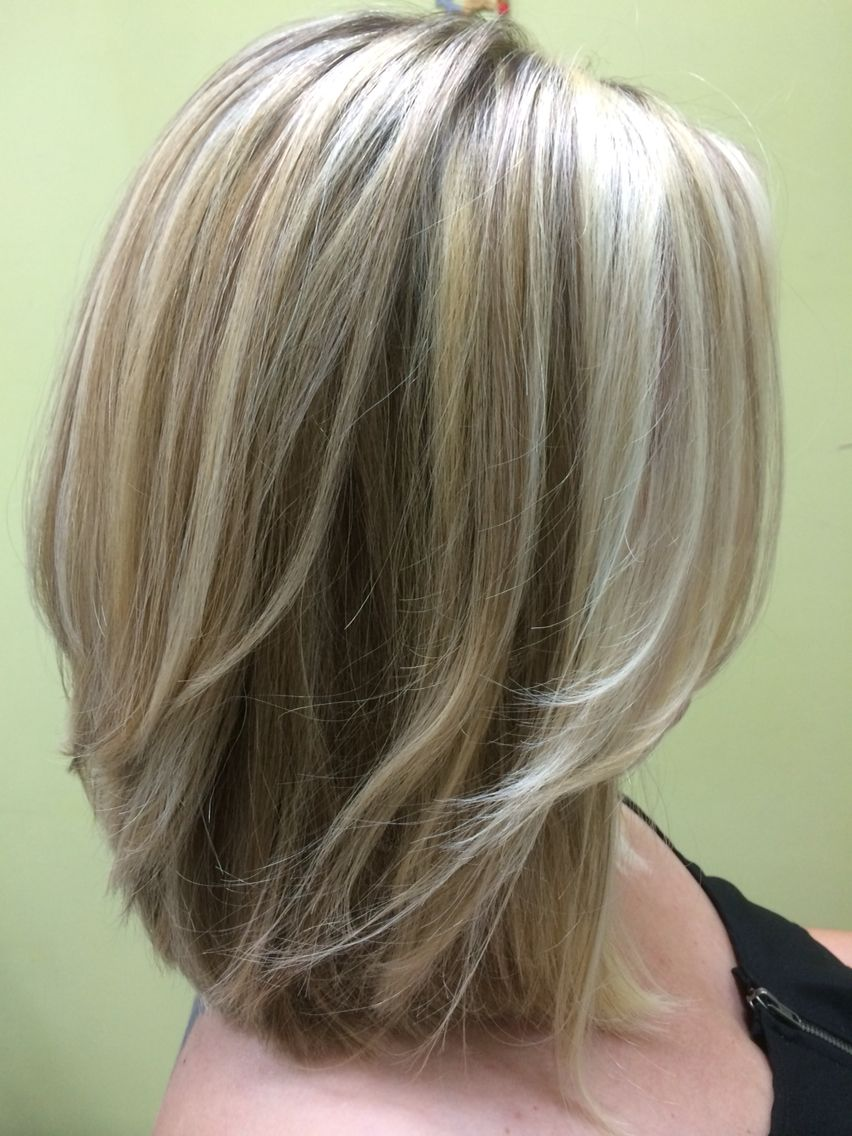 Three shades of blonde shoulder length layered bob hairs