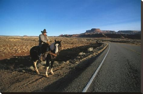 Stretched Canvas Print: Cowboy on his horse on a highway near Hanksville, Utah, USA : 24x37in #utahusa