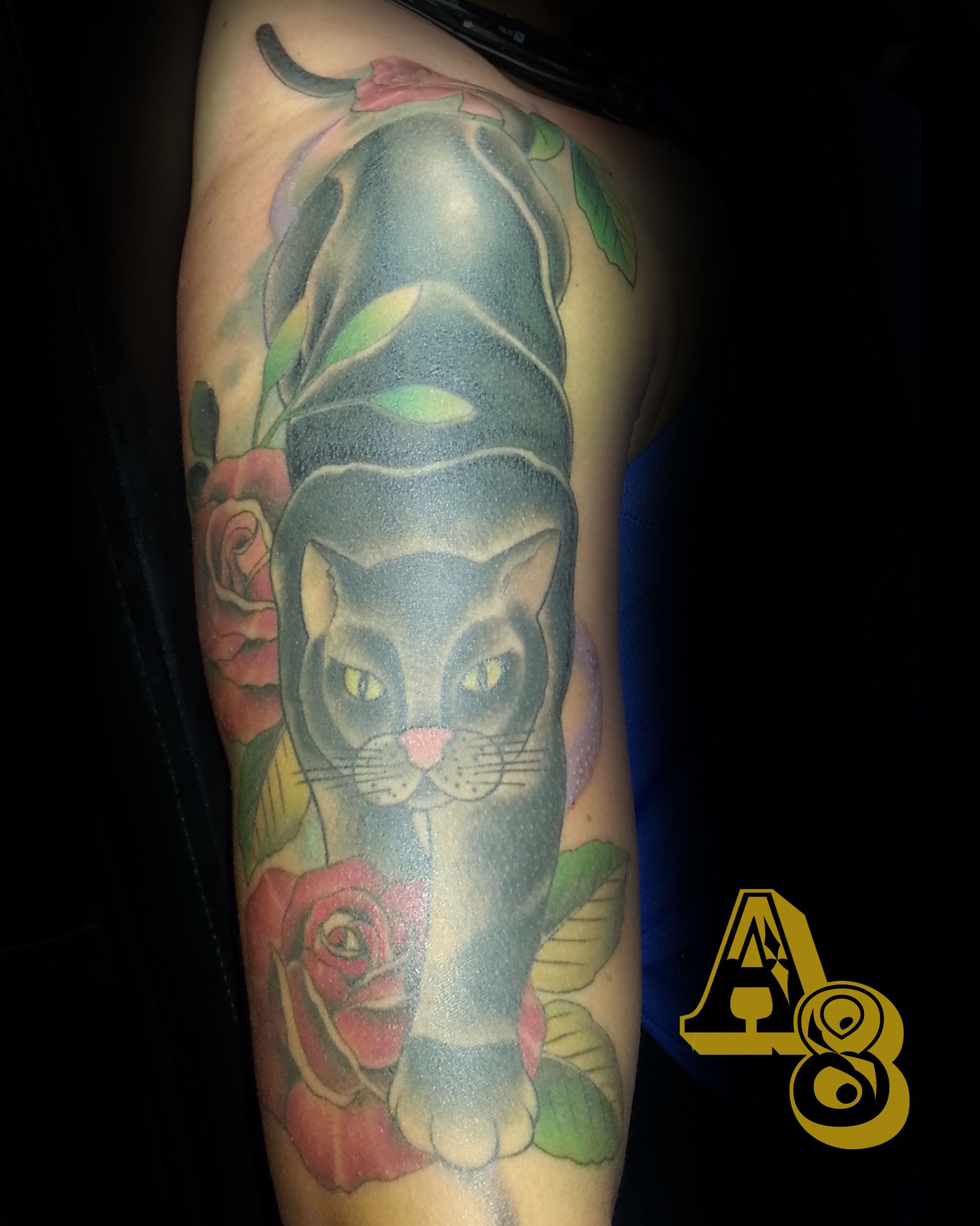 Black cat traditional tattoo with roses done by chad from