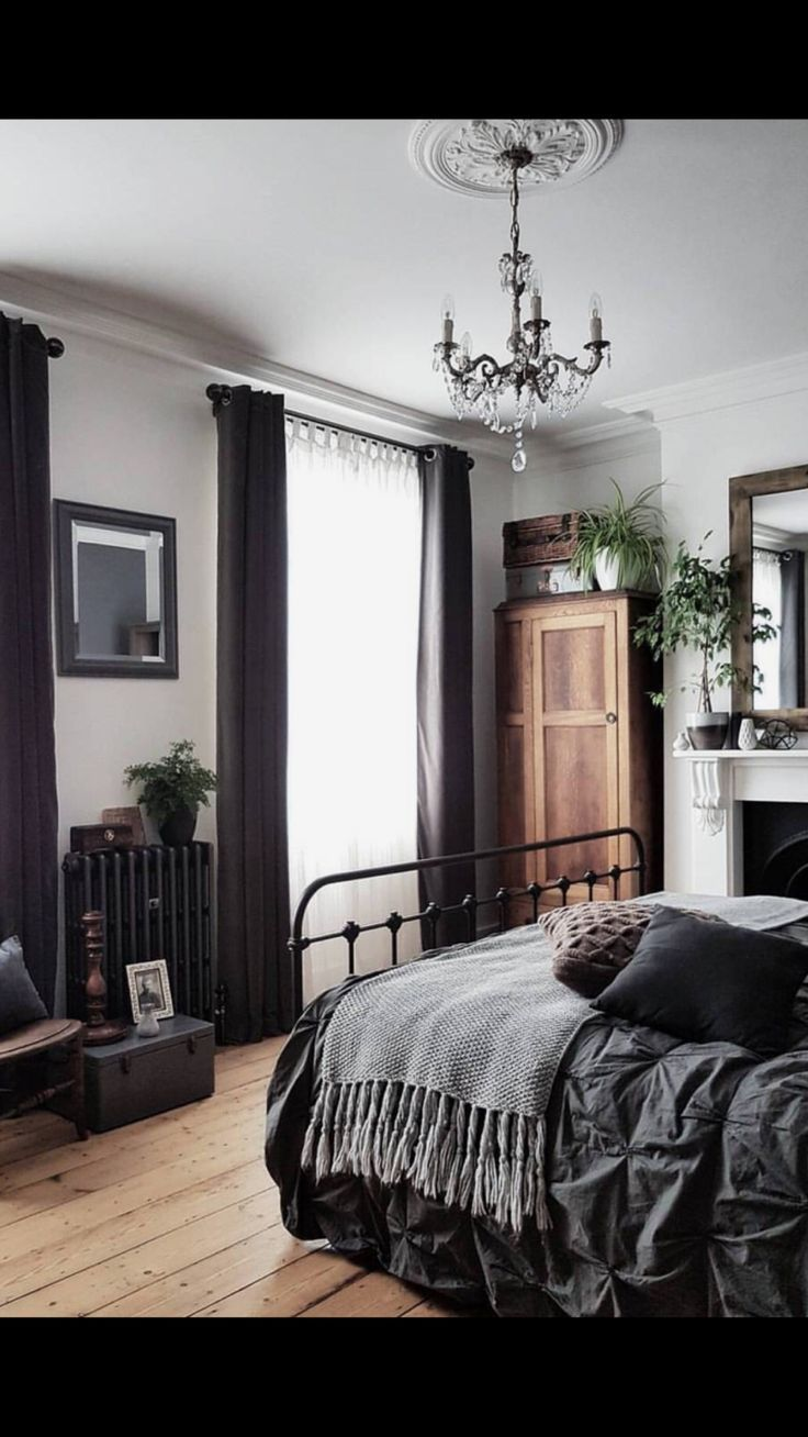 Photo of Love the dark bed sheets and curtains. The light wood floors complements them so