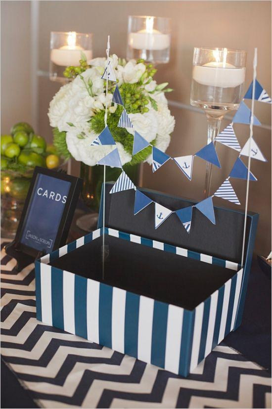 navy and white striped card box and diy banner #diy #cardbox #weddingchicks http://www.weddingchicks.com/2014/01/29/seaside-wedding-3