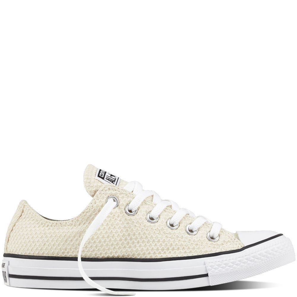 The Converse Women's Chuck Taylor All Star Low Top Snake Woven Buff/ Black  are the ultimate utility shoe. These slithering sneakers feature the  classic ...
