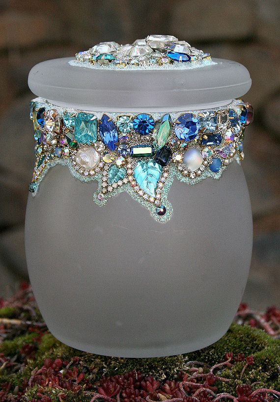 A collection of exquisite vintage rhinestones in a palette of blues, clear, and iridescent tumble with genuine freshwater pearls and a sprinkling