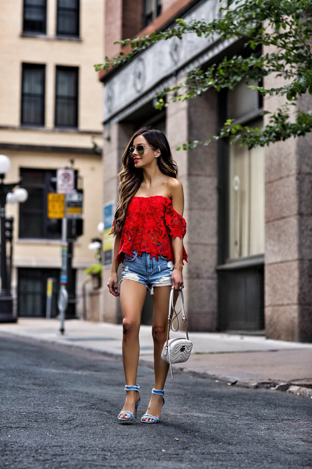 025cf112589 fashion blogger mia mia mine wearing a red lace off-the-shoulder top from  nordstrom and ripped denim shorts from revolve with a gucci marmont bag