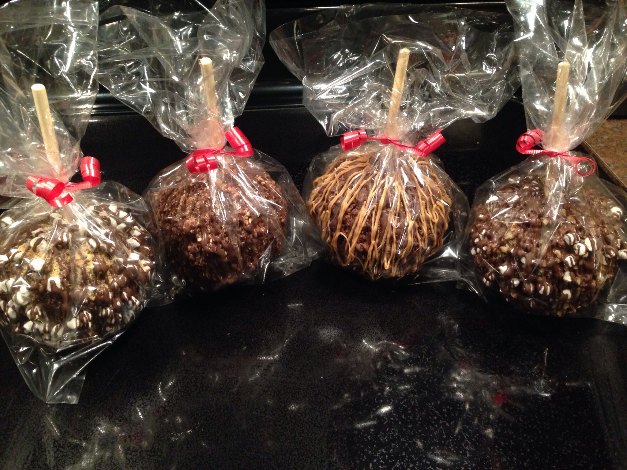 S'mores, Rocky Road, Snickers, and Reese's Cup Caramel Apples!!