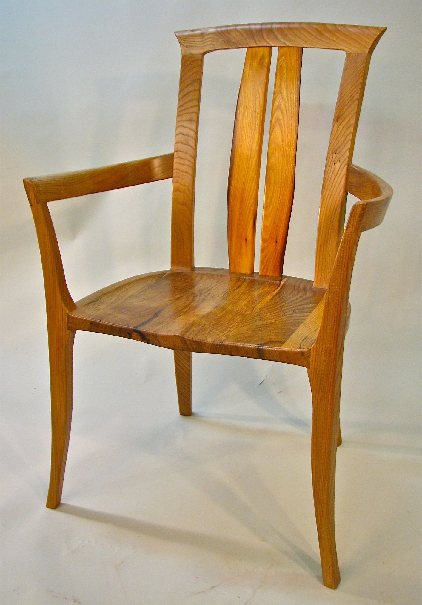 The barrel Chair Made from Elm Valley Oak and back splats of