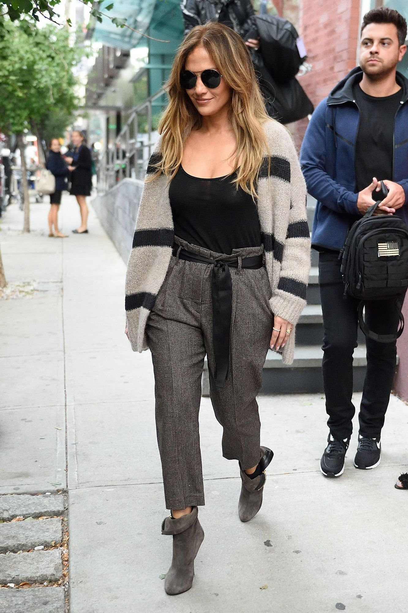 7f6526bab50 Jennifer Lopez Cinches the Modern Look of Newsboy Dressing in 2019 ...