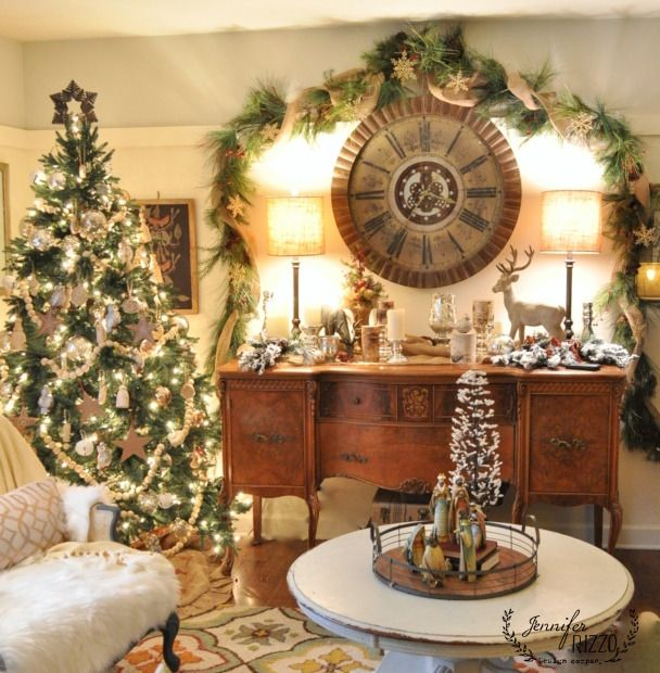I love how warm and pretty this room looks. Garland over clock.