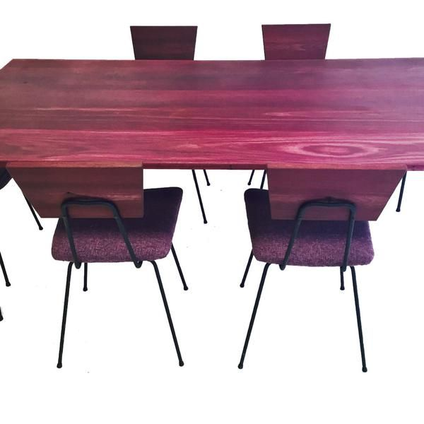 Dining set with original mid century wrought iron legs and chair bases    Fabricated purple heart wooden table top and seat backs arms by Atomic    All new. Purple Heart Wrought Iron Dining Set   Dining set with original