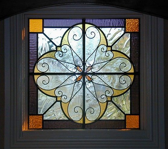 Glass, Bevelled Glass  Wrought Iron. Pretty design, maybe brighter colors.