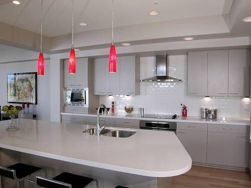 The Splash Of Color In These Mini Pendant Lights Over The Kitchen Island Adds Bold Interest To A