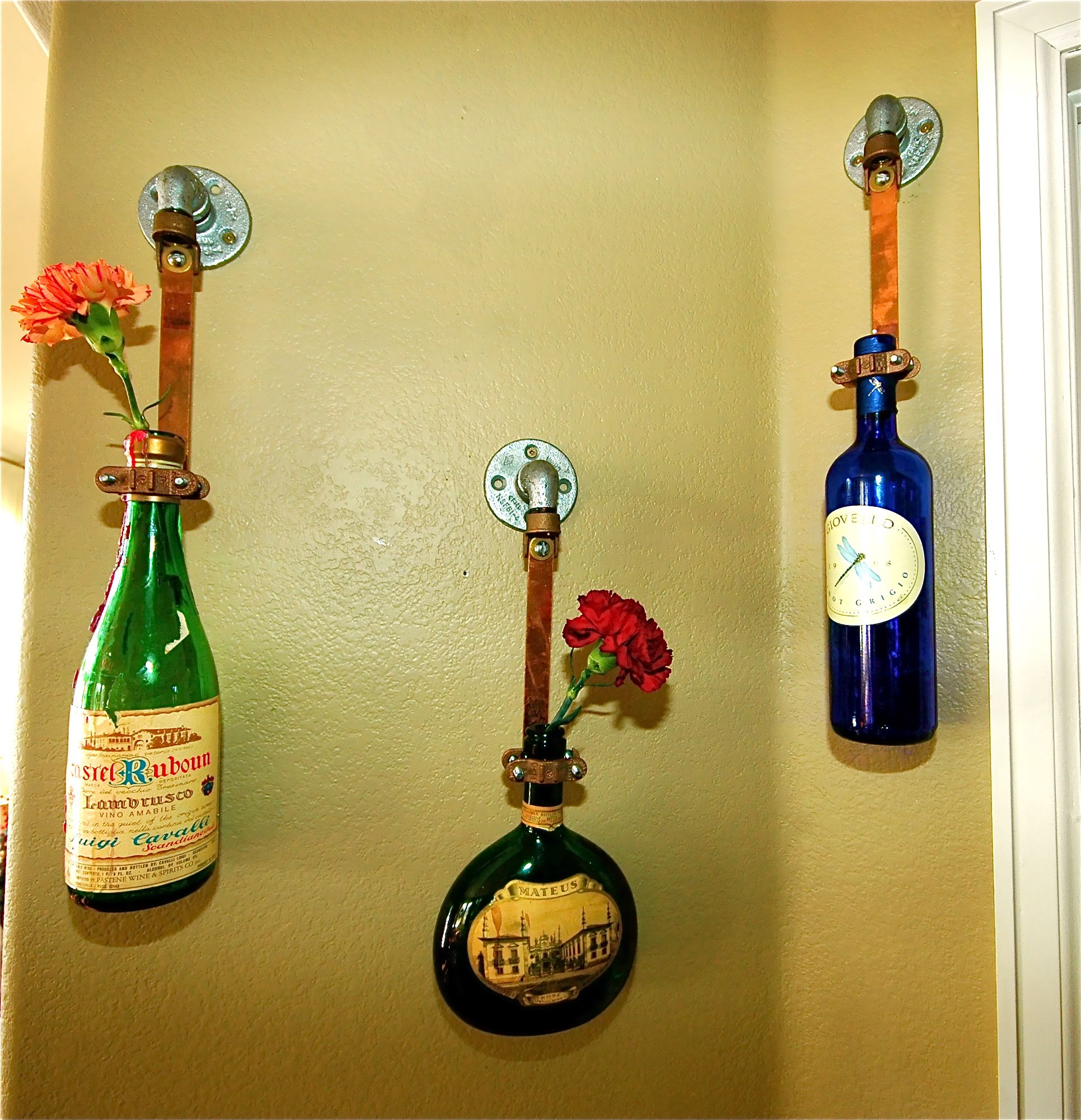 The plumbing isle + fabulous liquor/wine bottles = wall art ...