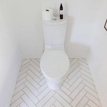 Modern Bathroom With White Herringbone Floors Modern Bathroom Herringbone Tile Bathroom Modern Powder Rooms White Tile Bathroom Floor