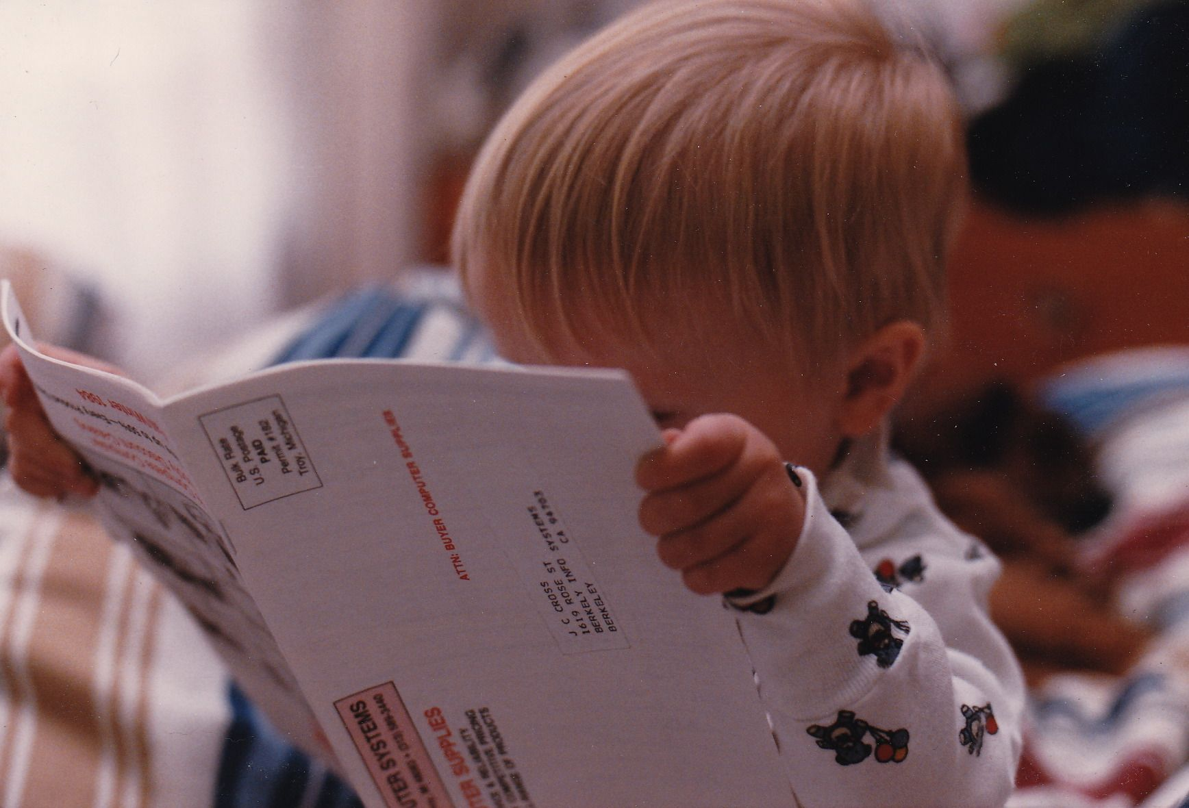 """Going through the motions. My preliterate son """"reading"""" a technical catalogue."""