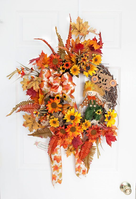 Welcome the fall harvest into to your home this with this adorable rustic scarecrow themed grapevine wreath. This colorful wreath is