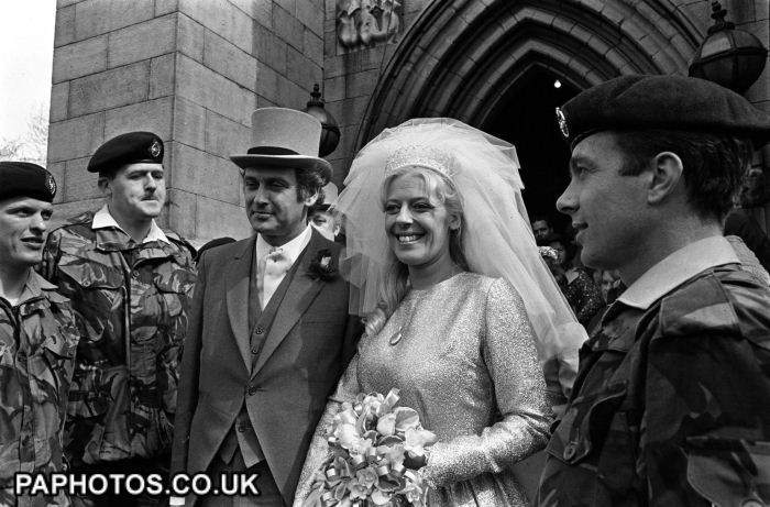 "Julie Goodyear, barmaid Bet Lynch of Coronation Street's ""The Rovers Return"" and Mr Tony Rudman after a special marriage blessing ceremony at the parish church in 1976."