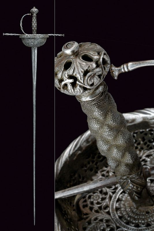 A beautiful pierced cup-hilted sword,    provenance:Spain dating: 17th Century .