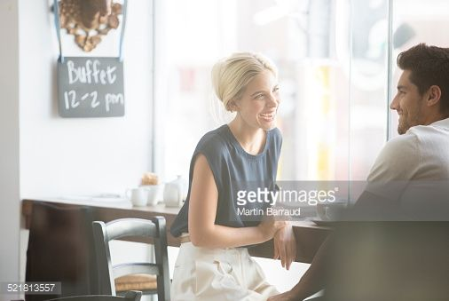 Stock Photo : Couple talking in cafe