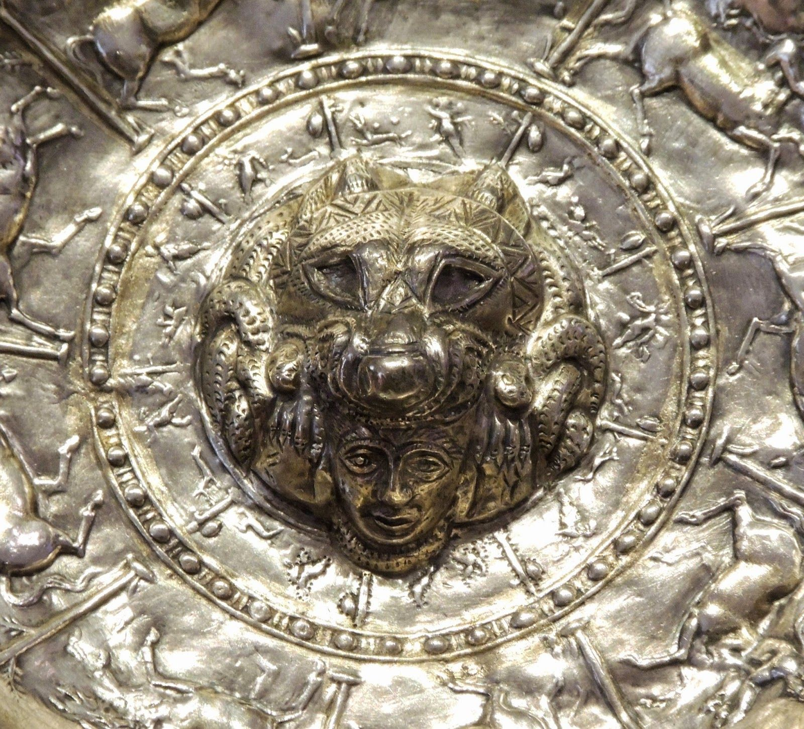 The wolf was a recurring symbol  in pre-roman iberian iconography, as well as their depiction as devouring a warriors head. Here in the Patera of Santiesteban (Jaén)
