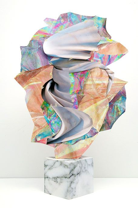 Erin O'Keefe // The holographic print against the dull tones of marble is a beautiful contrast