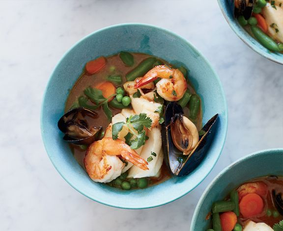 This lighter, brighter Thai-style curry cuts back on the coconut milk and boosts the flavor of the broth with shrimp, mussels, fish and vegetables.