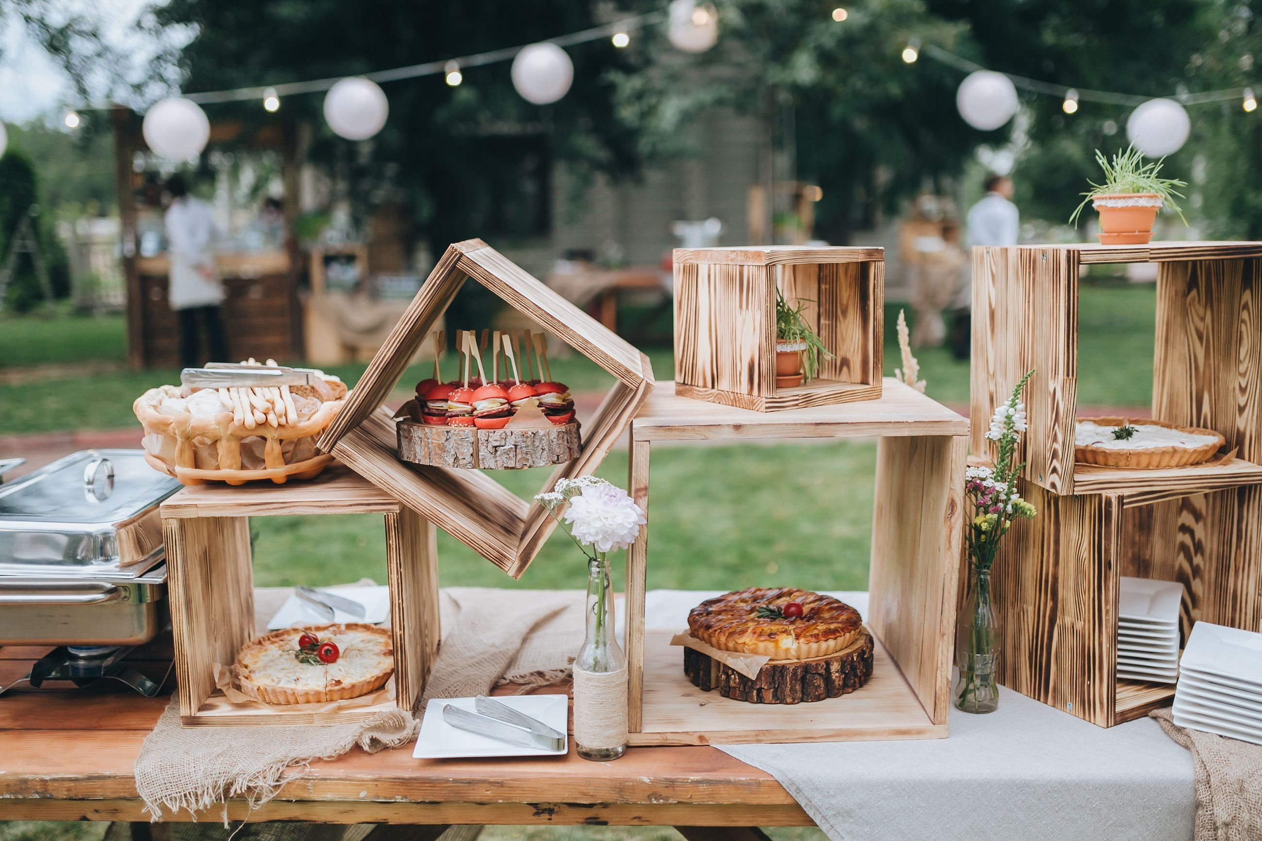 Barn wedding table settings  A rustic inspired dessert table is perfect for a garden wedding