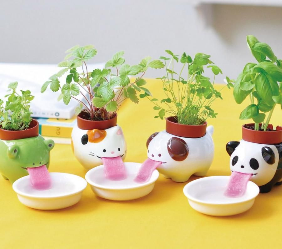 These Drinking Animal Planters Slurp Up Their Water Through A Long
