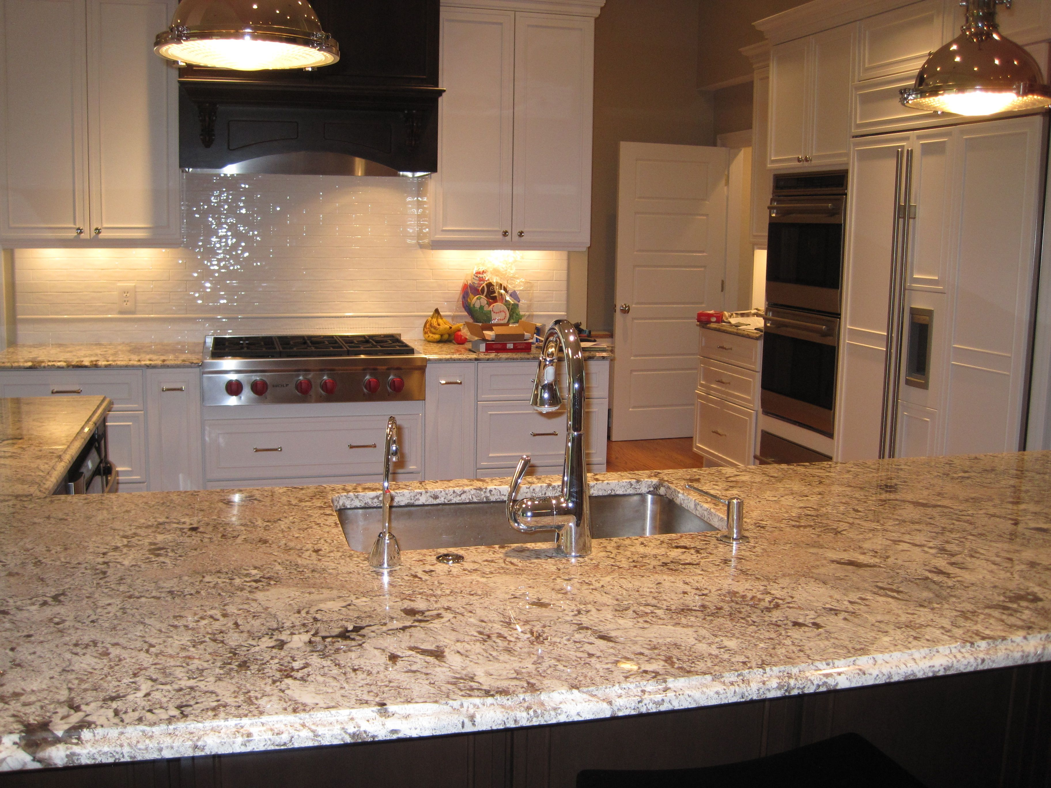 Bianco Antico Granite, dark island with white perimeter cabinets ...