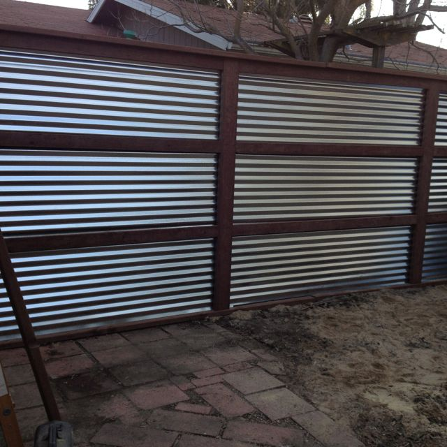 Galvanized corrugated metal and treated wood feature wall for Backyard feature wall ideas